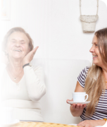 lady and old woman laughing together